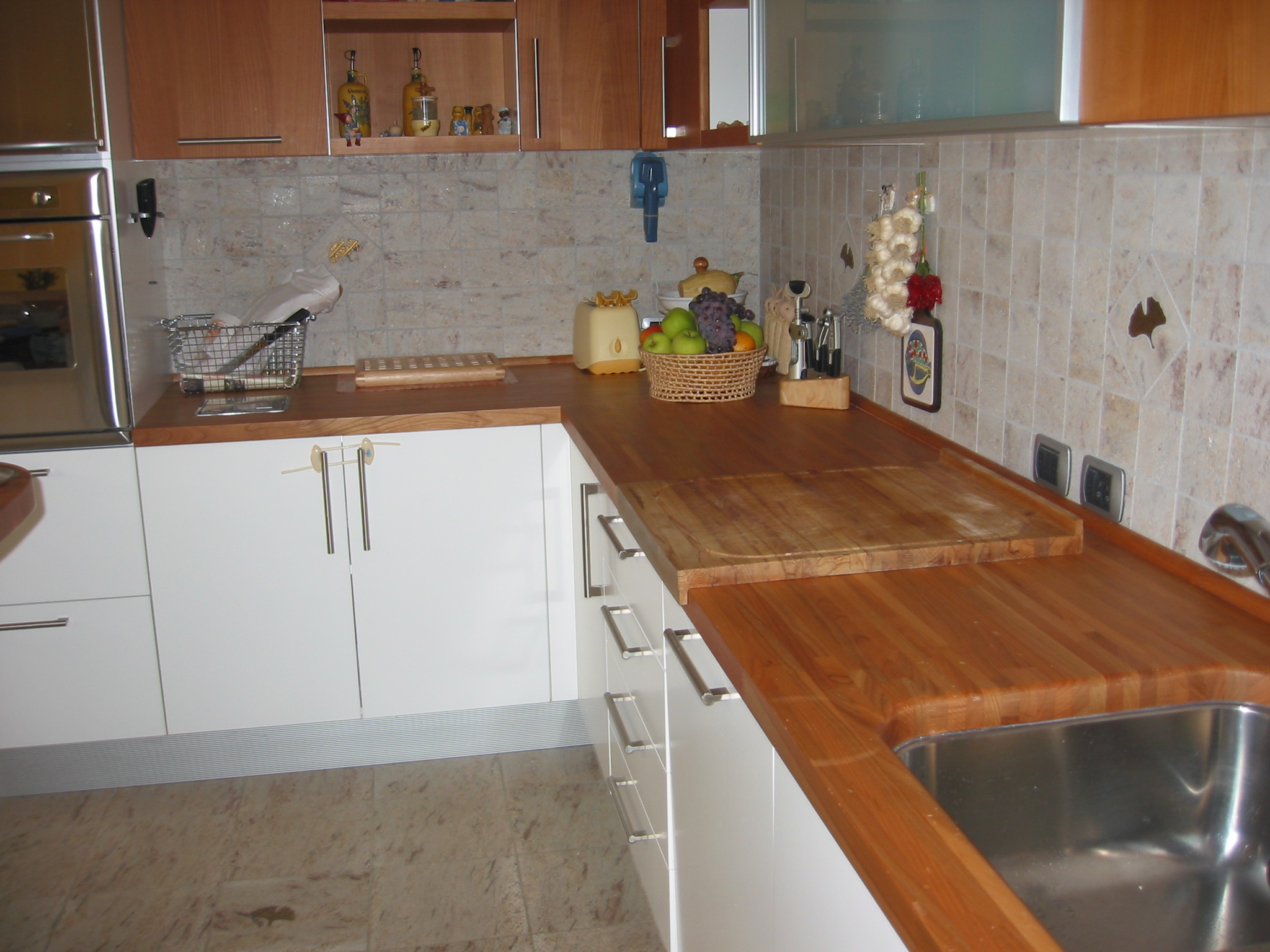 Cucine in granito la paltenghi - Rivestimento cucina no piastrelle ...